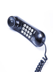 black telephone on white background