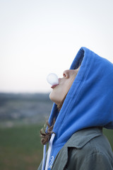 Girl blowing chewing gum bubble