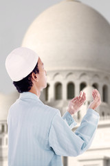 Boy muslim praying at mosque