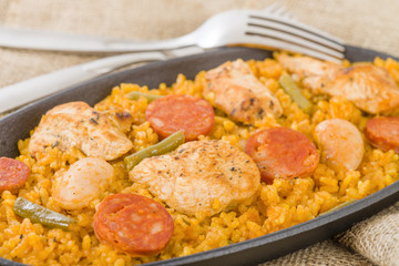 Paella Valenciana - Paella with chicken, sausage and vegetables