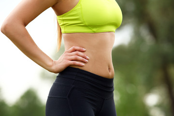 Beautiful torso of young woman in fitwear