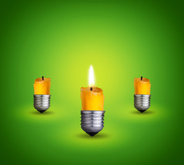 candles into lighting bulbs on green background.Idea concept.