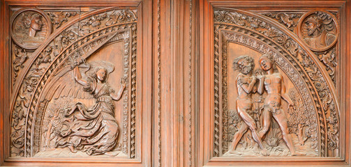 Madrid - Wooden relief expulsion of Adam and Eva