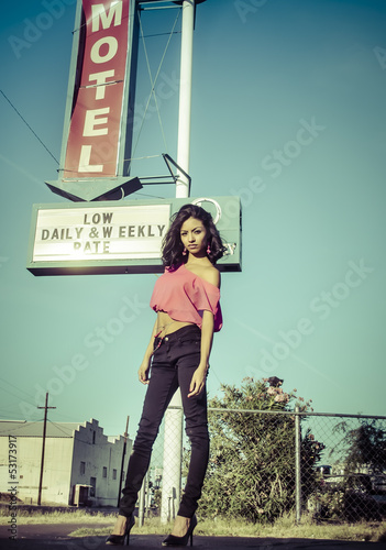 Motel sign with beautiful young woman