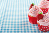 Cupcakes with strawberries and copy space