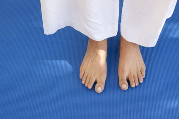 Feet on a blue mat