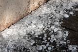 Big ice balls hail on the wooden floor