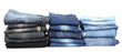 Many jeans stacked in a piles isolated on white