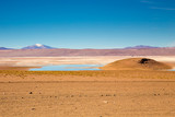 Desert with mountains, ice and lake in South America