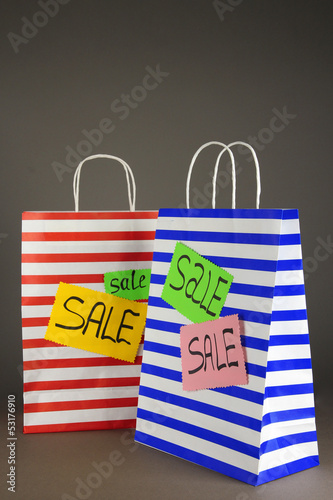 Striped bags on gray background