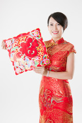 Chinese woman in cheongsam with traditional ornament