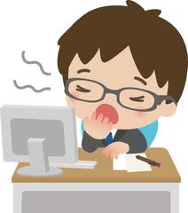 デスクワーク中にあくびをする男性