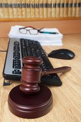Judge gavel with computer keyboard