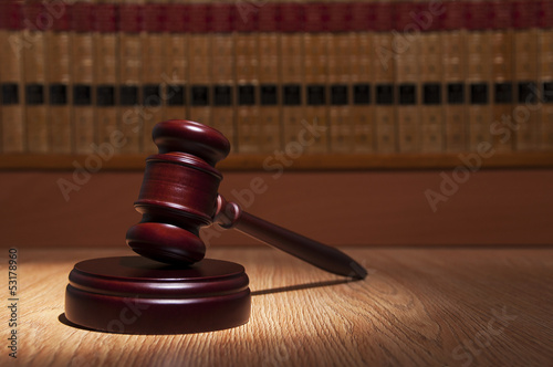 Judge  gavel with books in the background
