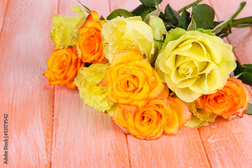 Beautiful bouquet of roses on table close-up