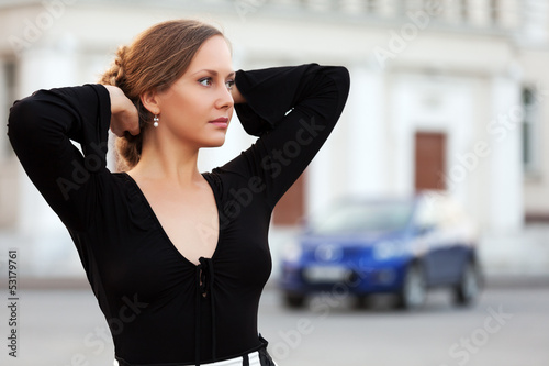 Beautiful woman daydreaming on the city street