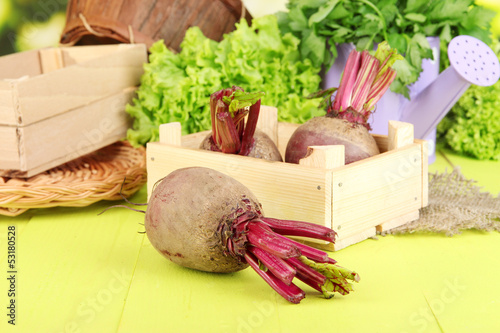 Young beets on wooden box on wooden table close-up