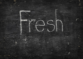 Chalk on black board: Fresh