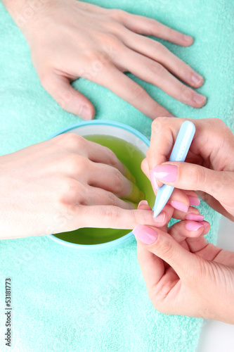 Man doing manicure in salon