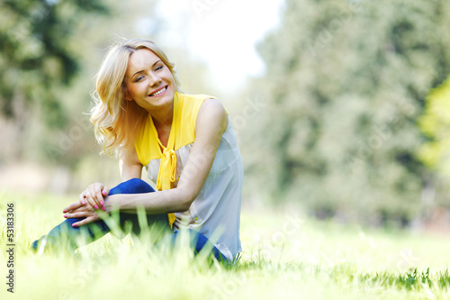 Woman sitting on grass