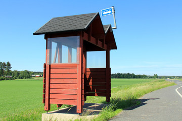 Wooden Bus Stop Shelter by Highway