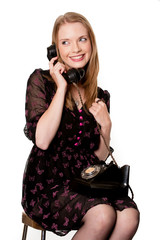 Attractive blonde woman on vintage phone  - isolated on white