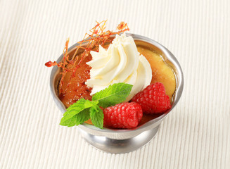 Creme brulee with raspberries and whipped cream