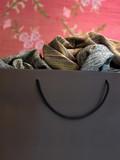 Textile pieces into a bag poster