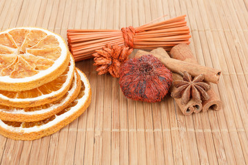 Star Anise, cinnamon and dried orange wooden background