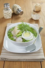 Vegetable soup with sorrel and boiled fish