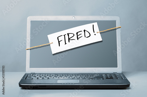 laptop with fired note