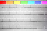 Wall mit colored bricks with gay flag colors
