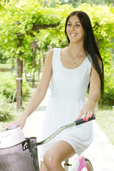 beautiful young woman ride bicycle