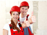 Fototapety Worker showing thumbs up in site