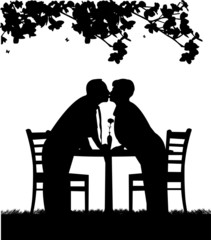 Silhouette of  lovely retired elderly couple who kiss