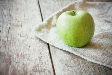 green apple on wooden background