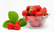 Red strawberry in the bowl isolated
