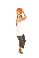 Young boy throwing basketball