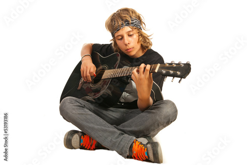 Rocker teen with accoustic guitar