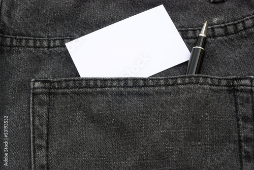 blank business card and ball point in jean back pocket