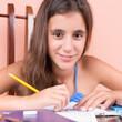Beautiful hispanic girl studying at home