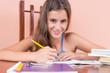 Hispanic girl studying at home and smiling