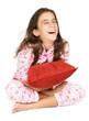 Hispanic teenager wearing pajamas and laughing