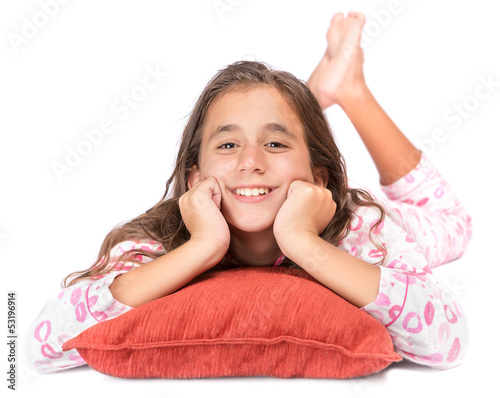 Girl lying on the floor wearing her pajamas