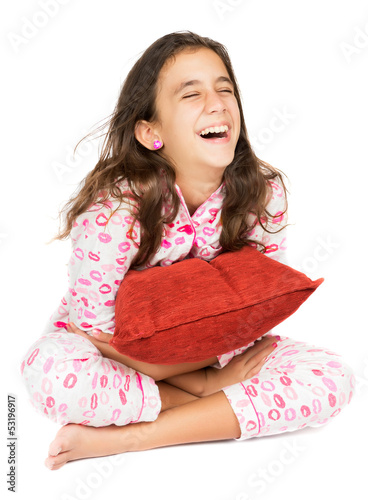Hispanic teenager wearing pajamas and laughing