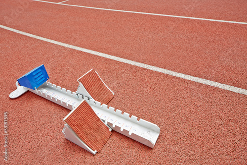 Closeup starting blocks on red race track