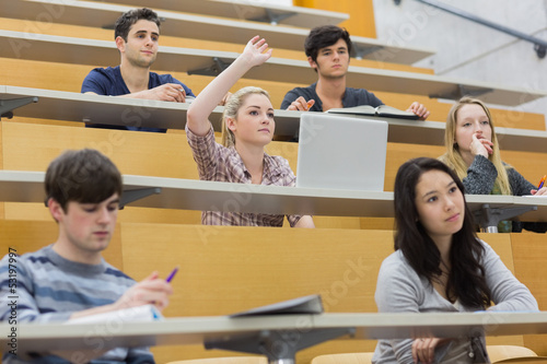 Students having a lesson in the lecture hall