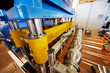 Automated line for forming shaped metal sheets