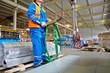 Workers operates crane-beam
