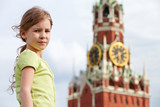 Portrait of girl against Spassky tower of Moscow Kremlin